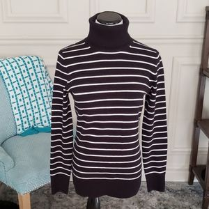 Black and white turtleneck sweater